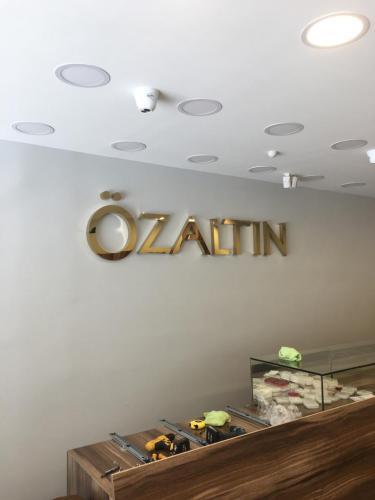 İç_Mekan_Gold_Paslanmaz_Logo_Tabela